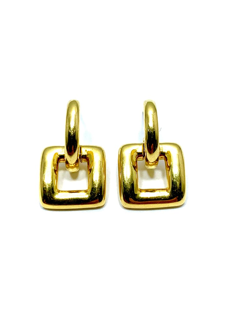 Simple and easy to wear, these Tiffany & Co. door knocker earrings will be a great addition to any wardrobe.  They are made in 18 karat yellow gold, and sit in the ear on a post.  The bottom portion of the earring is hinged to allow for movement.