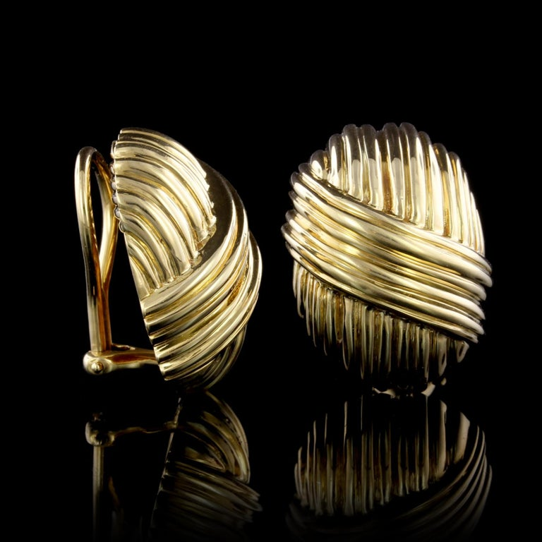 Tiffany & Co. 18K Yellow Gold Earrings. The earrings are ribbed domes, length 7/8