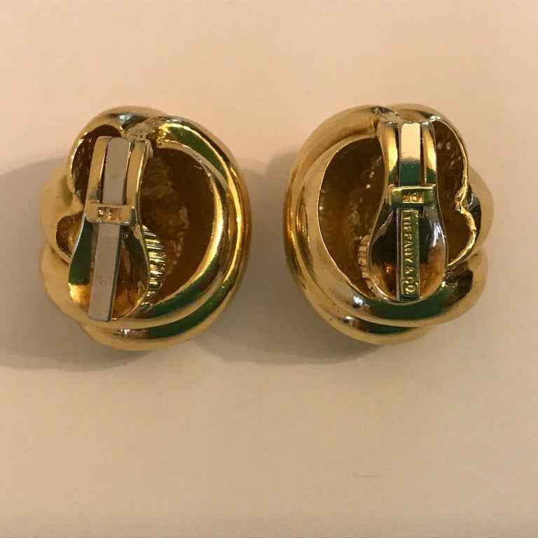 Tiffany & Co. 18k Yellow Gold Knot Motif Clip On Earrings Vintage      Here is your chance to purchase a beautiful and highly collectible designer pair of earrings.  Truly a great piece at a great price!     Weight: 37.7 grams    Dimensions: 1