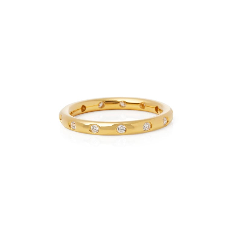 This Wedding Ring by Elsa Peretti for Tiffany & Co features Thirteen Round Brilliant Cut Diamonds Totalling 0.26cts. Set in 18k Yellow Gold. Finger Size UK O 1/2, EU Size 55, USA Size 7. Complete with Xupes Presentation Box. Our Xupes reference is