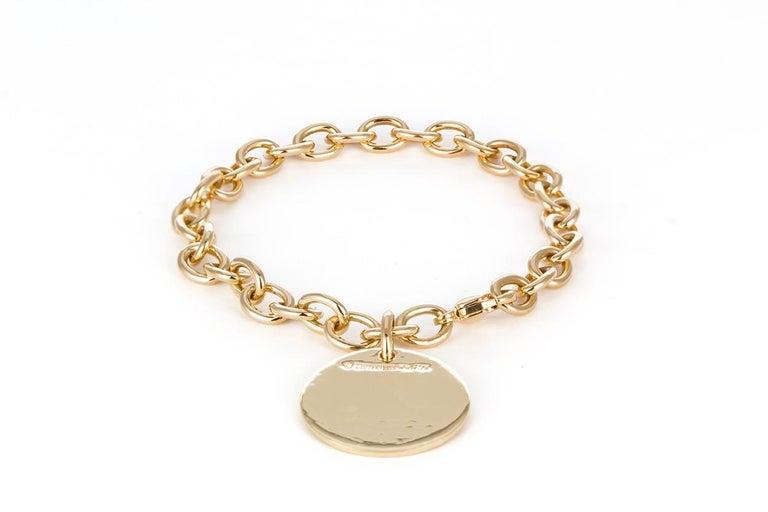 Contemporary Tiffany & Co. 18 Karat Yellow Gold Round Charm Bracelet For Sale