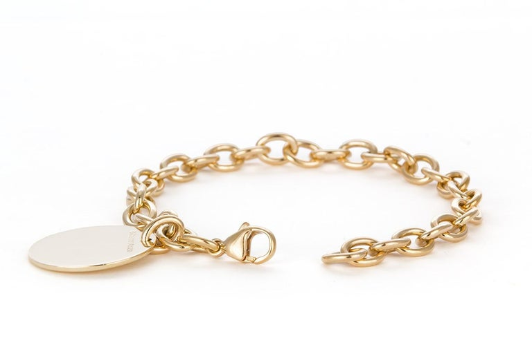 Women's Tiffany & Co. 18 Karat Yellow Gold Round Charm Bracelet For Sale