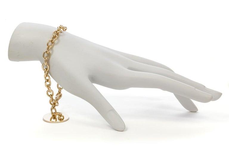 Tiffany & Co. 18 Karat Yellow Gold Round Charm Bracelet For Sale 1