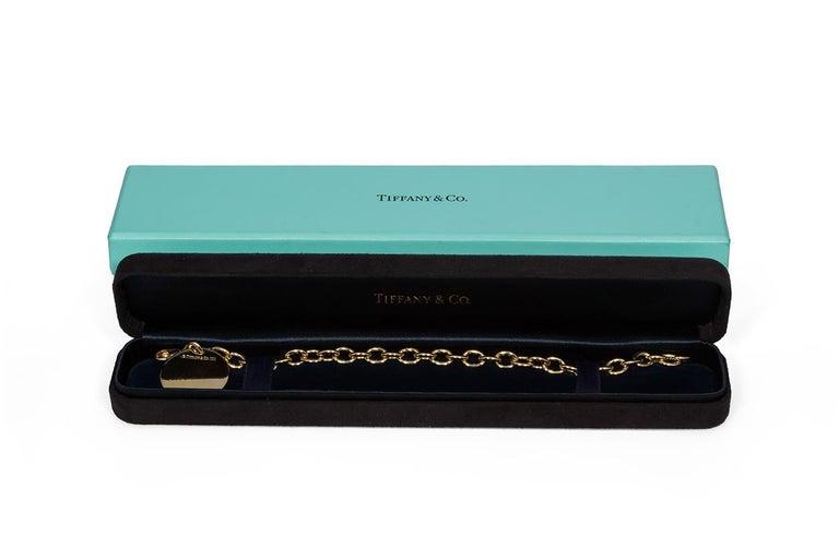 Tiffany & Co. 18 Karat Yellow Gold Round Charm Bracelet For Sale 2