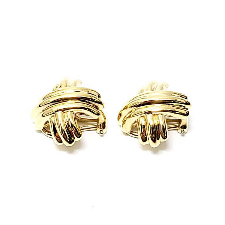 Tiffany & Co. 18K Yellow Gold Signature X Crossover Clip-On Earrings  These authentic Tiffany & Co. earrings are approx. 18mm x 18mm (approx. 3/4
