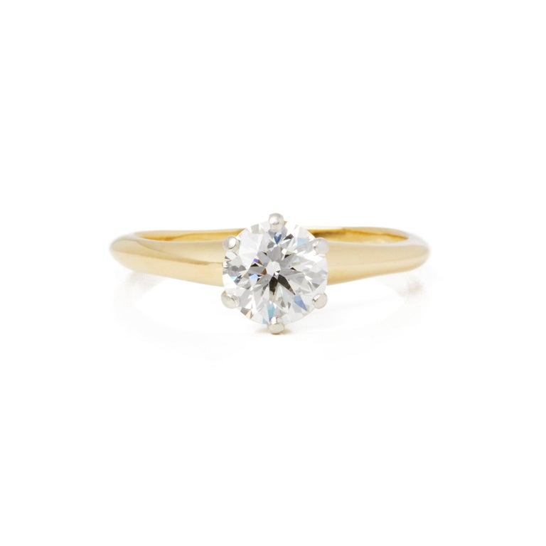 This Ring by Tiffany & Co features a Single Round Brilliant Cut Diamond G Colour, VS2 Clarity in a claw setting totalling 0.85cts. Mounted in 18k Yellow Gold. Finger Size UK L, EU Size 52, USA Size 6. This Ring can be re-sized. Complete with