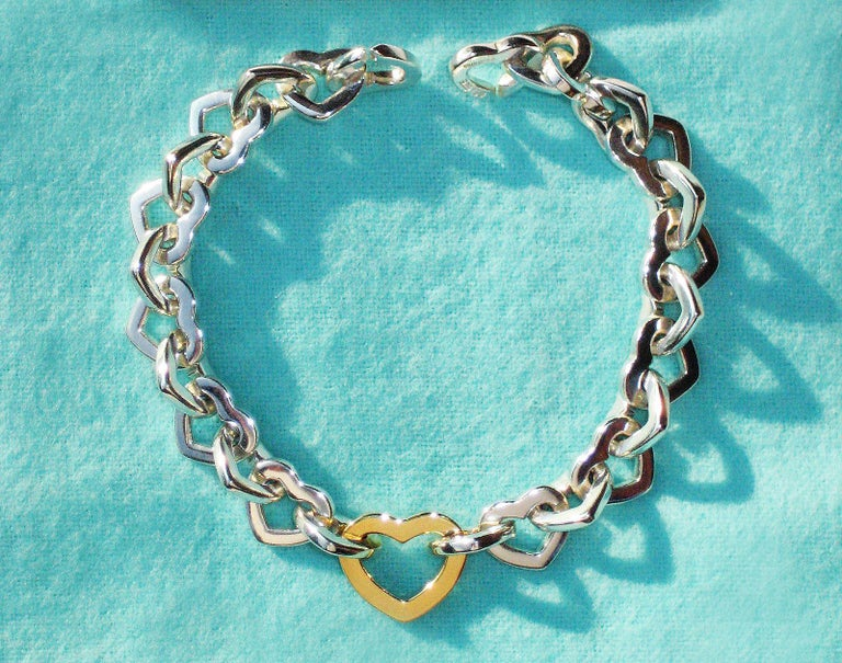100% Guaranteed Authentic Tiffany & Co. 18K Gold & 925 Sterling Silver Heart Bracelet, Hallmarked 750 & 925 ©Tiffany & Co 18K Gold Heart Measures 5/8
