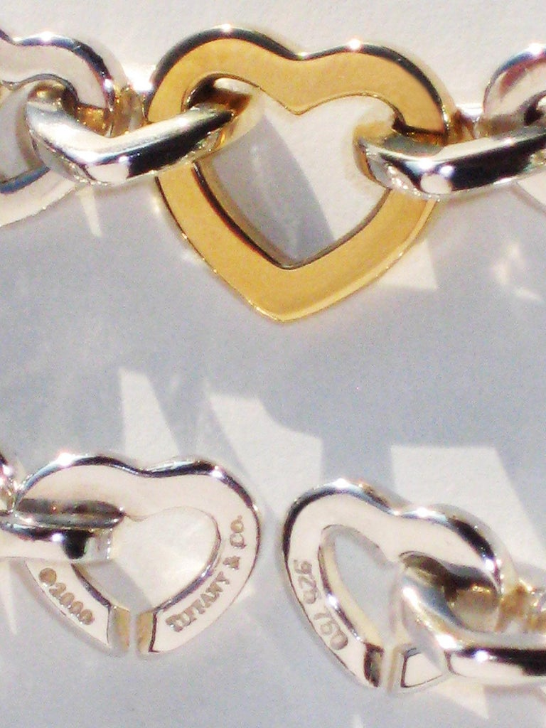 Modern Tiffany & Co. 18 Karat Yellow Gold and Sterling Silver Heart Bracelet For Sale