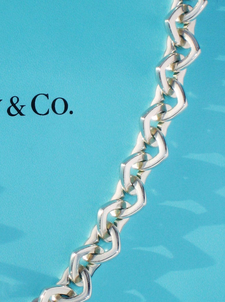 Tiffany & Co. 18 Karat Yellow Gold and Sterling Silver Heart Bracelet In Excellent Condition For Sale In Los Angeles, CA