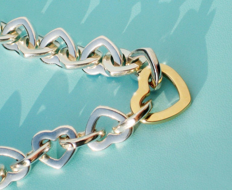 Tiffany & Co. 18 Karat Yellow Gold and Sterling Silver Heart Bracelet For Sale 1