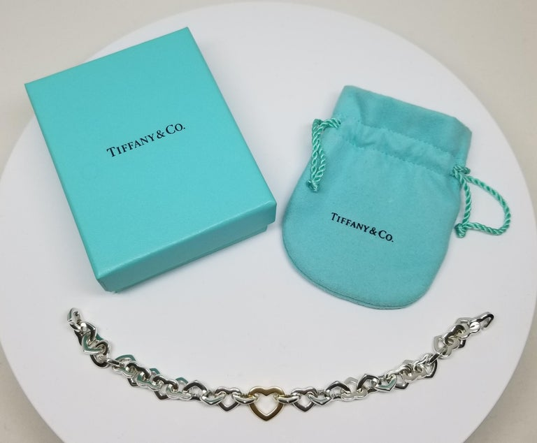 Tiffany & Co. 18 Karat Yellow Gold and Sterling Silver Heart Bracelet For Sale 3