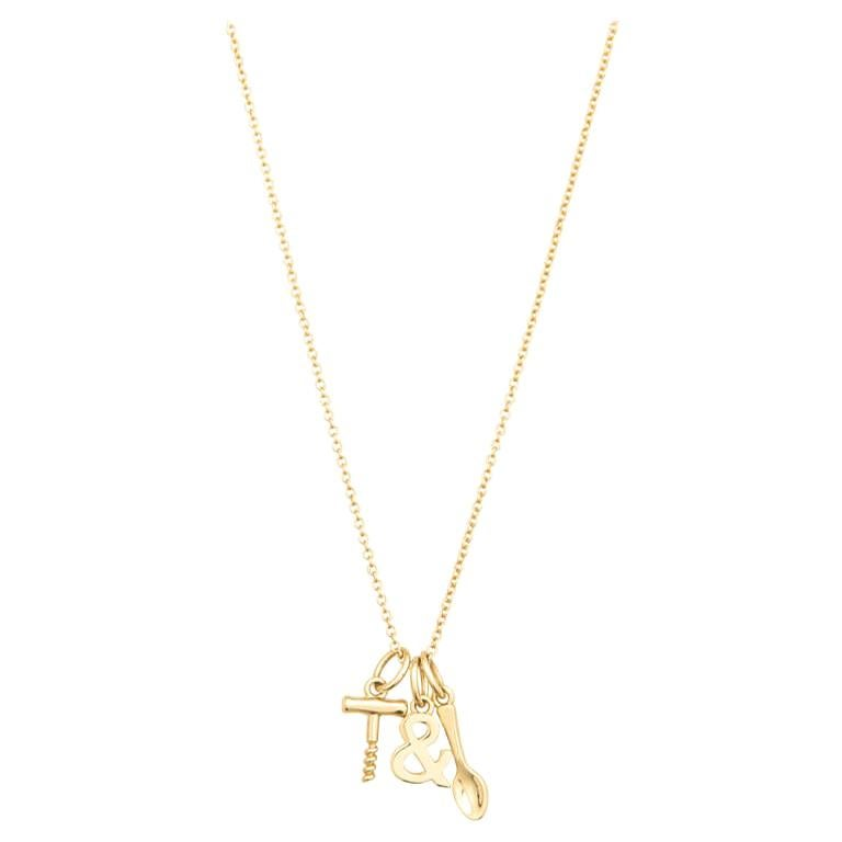 Tiffany & Co. 18K Yellow Gold Wine and Dine Pendant Necklace For Sale