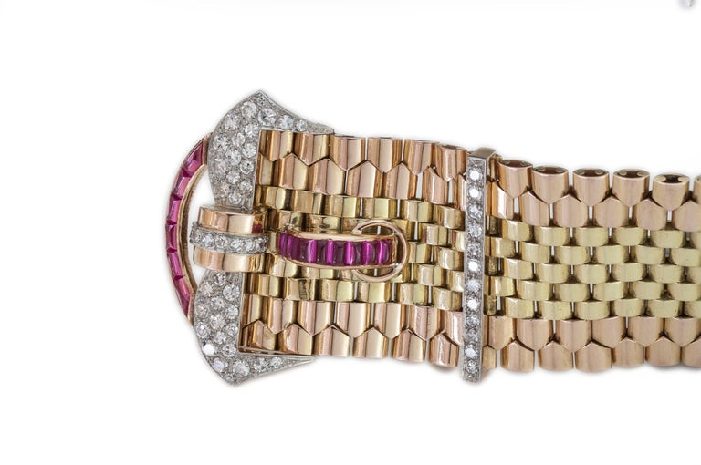 Tiffany & Co solid 18kt yellow and rose gold belt style bracelet with rubies and diamonds Designer / Maker: Tiffany & Co Made in 1940's Fully hallmarked.  Dimensions - Length x Width: 21 x 4 cm Weight: 110 grams  Diamonds -  Cut: Round brilliant