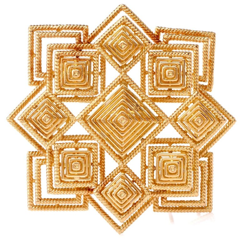 This authentic Tiffany & Co. 1970s lapel brooch and pendant of bold and sensational aesthetic and artistic workmanship is crafted in 18 karat yellow gold and incorporates a total number of 9 pyramidal profiles, the largest positioned at the center,