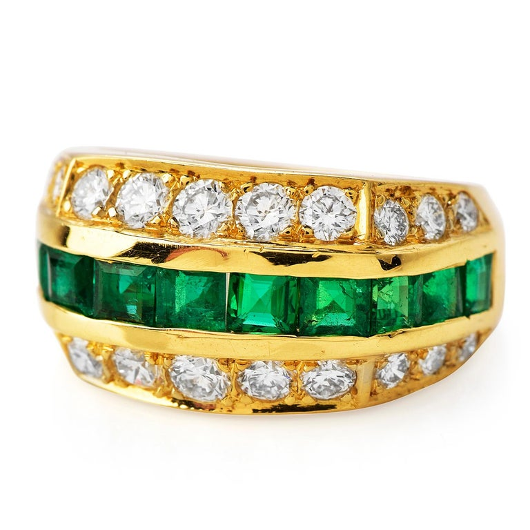 This Tiffany & Co Diamond Emerald 18K Gold Lovely Band Ring is full of femininity and softness weighing 6.3 grams.  Expertly crafted in solid 18K yellow gold, composed of (22) round-cut, prong-set, Genuine Natural Diamonds weighing an approx. of