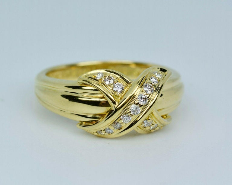 Tiffany & Co 18k Yellow Gold Round Diamond X Shaped Ring Ring Size 7.25 7.3 Grams 15 White Round Brilliant Cut Diamonds 0.25 Carats Total Weight Color: F Clarity: VS2  This is a beautiful Tiffany & Co. diamond ring that shows off these round bright