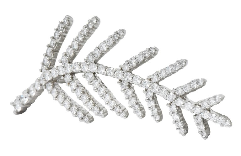 Significant abstract foliate motif  Set throughout with round brilliant cut diamonds, weighing approximately 3.50 carats total, F/G color and VS clarity  Fully signed Tiffany & Co. dated 1996 and stamped PT950 for platinum  CTW: 3.50  Measures: 2
