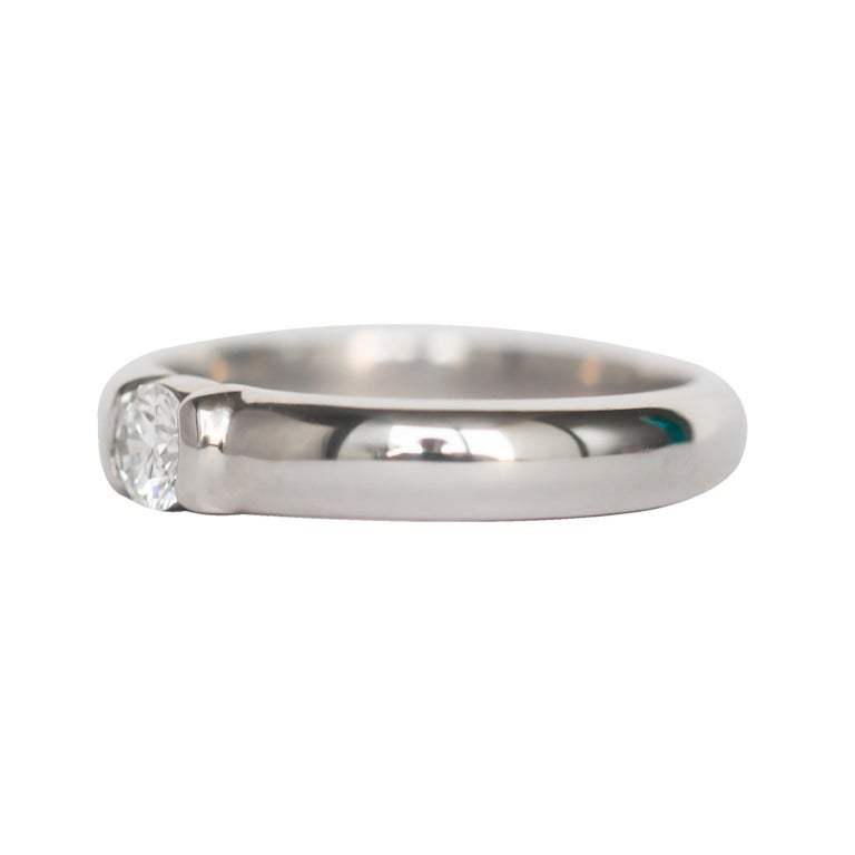 Item Details:  Ring Size: Approximately 5.85 Metal Type: Platinum Weight: 6.8 grams  Center Diamond Details Diamond Registration Number: 18808242/F02090113 Shape: Round Brilliant Carat Weight: .20 carat Color: F Clarity: VVS2  Finger to Top of Stone
