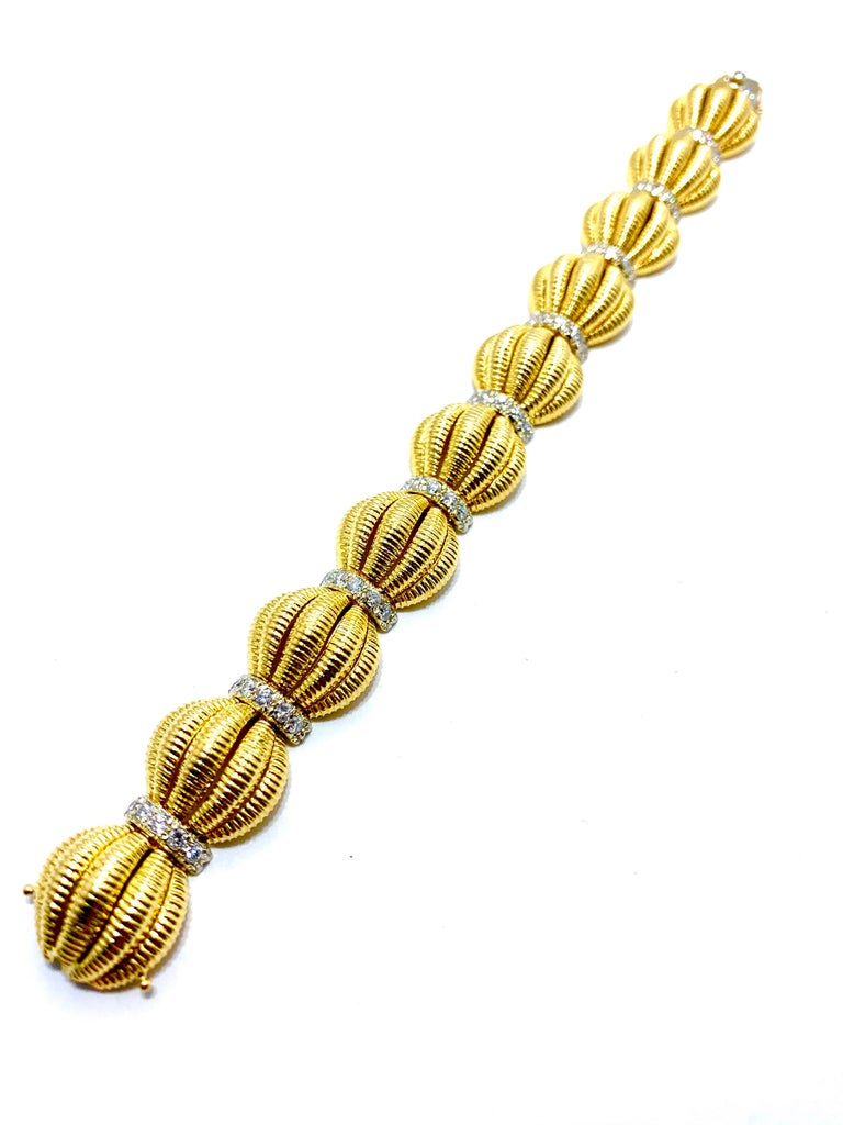 This is a rare beauty!  A Tiffany & Co. 2.50 carat round brilliant Diamond and 18 karat yellow gold domed textured link bracelet.  The bracelet is designed with a single row of five diamonds each at each link junction.  the diamonds are E-F color,