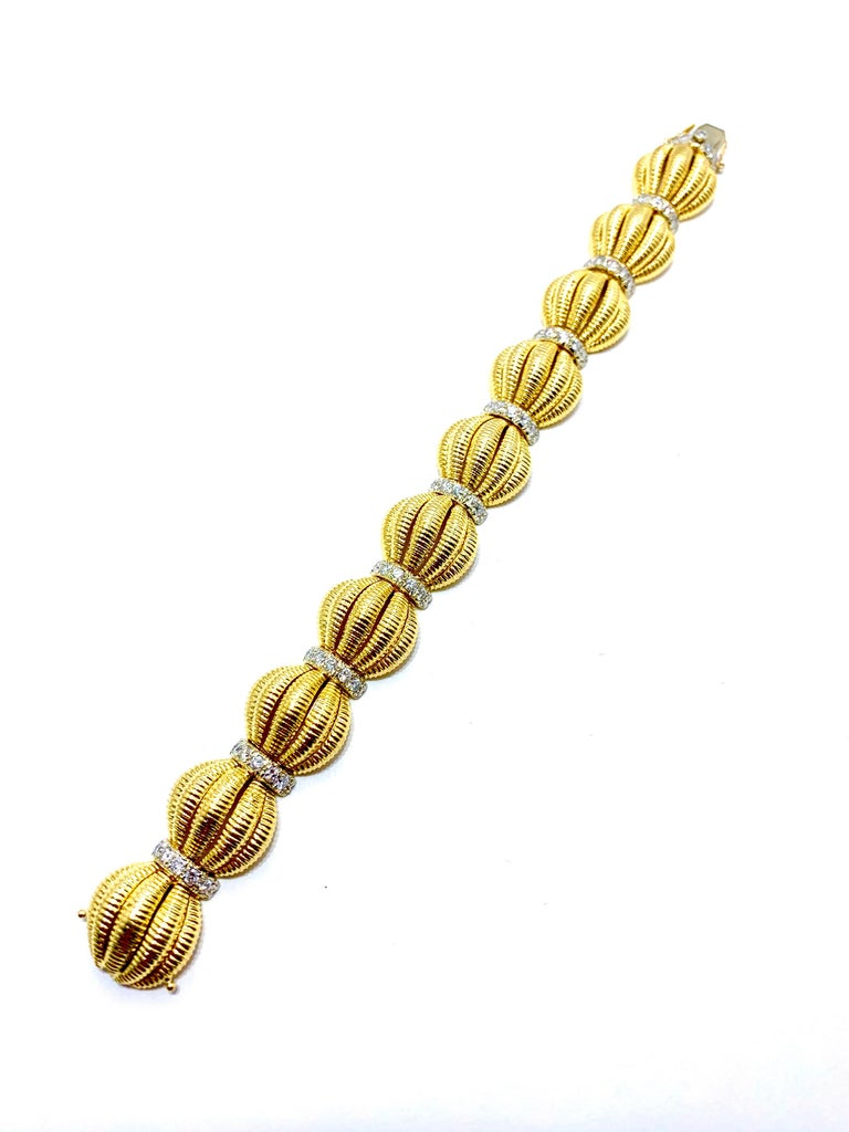 Retro Tiffany & Co. 2.50 Carat Round Diamond and Domed Textured Gold Link Bracelet For Sale