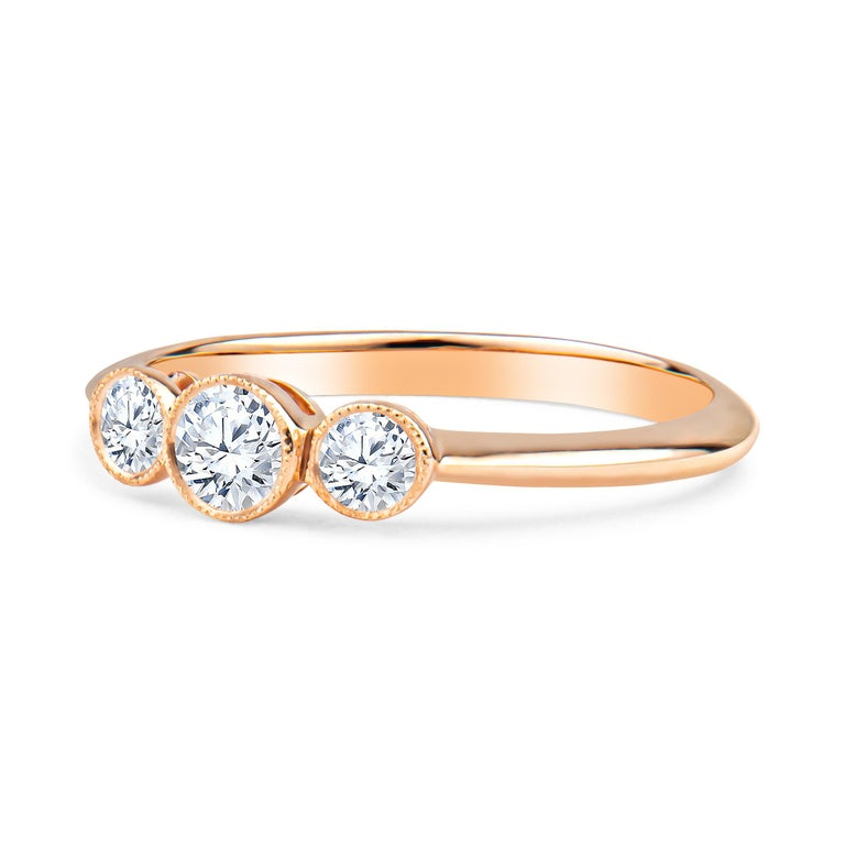 Tiffany & Co. 3-stone rose gold milgrain bezel ring, 0.33ctw in 3 round diamonds of D-F color, VS2-VVS1 clarity, in 18kt rose gold ring. MSRP is approximately $3500. Size 6.5