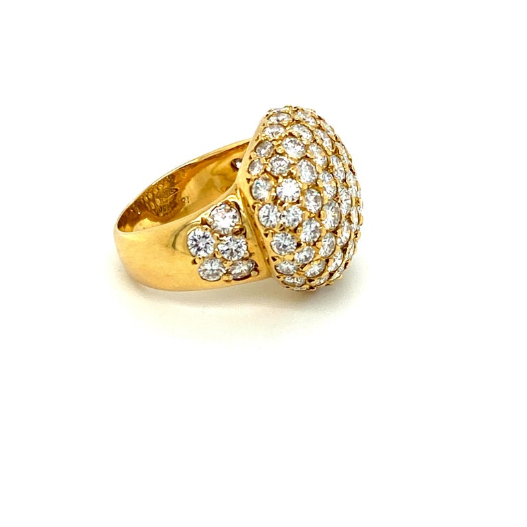 This Tiffany & Co. pave diamond and 18k gold dome ring features 83 round brilliant diamonds totaling approximately 4.22cts.  The diamonds are high-quality F/G VS to VVS, according to documentation provided by Tiffany & Co to assist with the owner's
