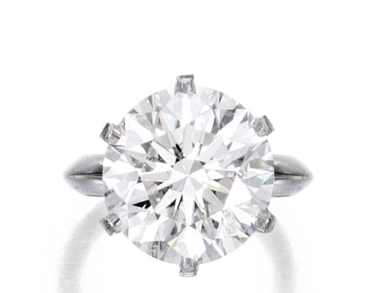 The classic and timeless six prong authentic Tiffany & Co. 5 carat round brilliant cut diamond ring set in solid platinum