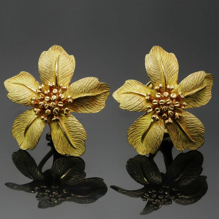 These gorgeous Tiffany & Co. flower earrings feature five stylized petals in etched, satin-finished 18k yellow gold centering elegant stamens. Completed with omega clip-on backs with posts. Made in United States circa 1980s. Measurements: 1.06