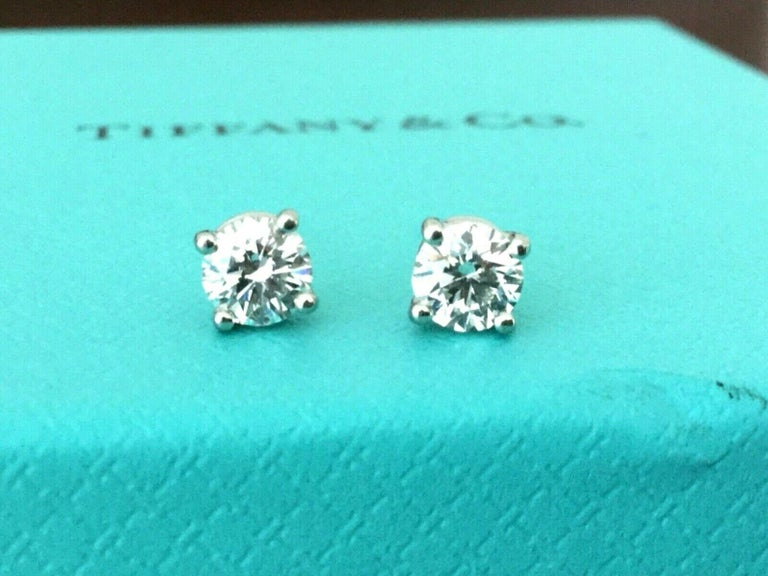 Offered for your consideration is a like new set of platinum and diamond Tiffany & Co Stud earrings with the original Tiffany diamond certificates.  It is super rare to find a set of Tiffany stud earrings with the original paperwork as 99% of