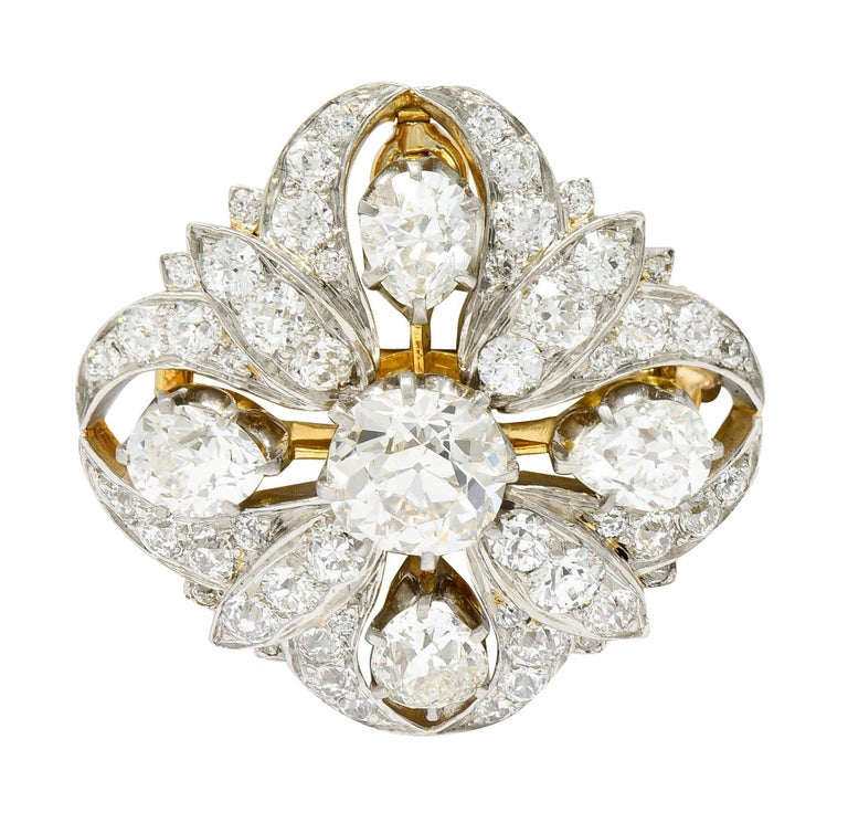 Quatrefoil pendant brooch centers an old mine cut diamond weighing approximately 1.80 carats - J color with VS clarity  Surrounded by four pear cut diamonds weighing in total approximately 2.50 carats - J/K color with SI clarity  Accented throughout