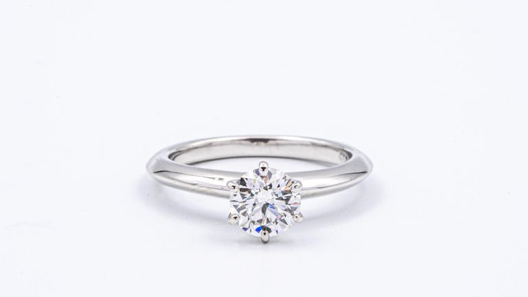 Classic Tiffany & Co Round Brilliant Solitaire Engagement Ring featuring a 0.77 ct Excellent Cut Center G color, VS1 clarity, finely crafted in a 6 prong Platinum Mounting.  Includes Original Tiffany certificate and Box.   Stamped: Tiffany & Co. PT