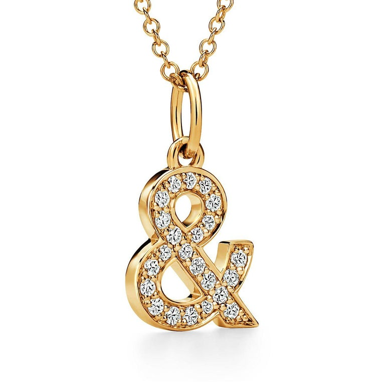 Round Cut Tiffany & Co. Ampersand Pendant in 18k Gold with .07 Ctw Diamonds For Sale