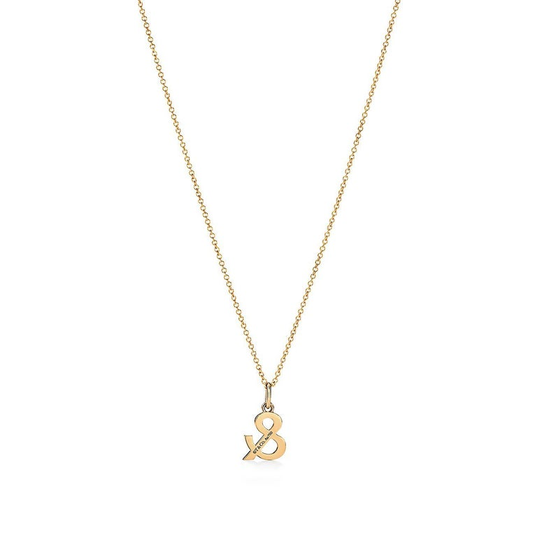 Tiffany & Co. Ampersand Pendant in 18k Gold with .07 Ctw Diamonds In New Condition For Sale In Houston, TX
