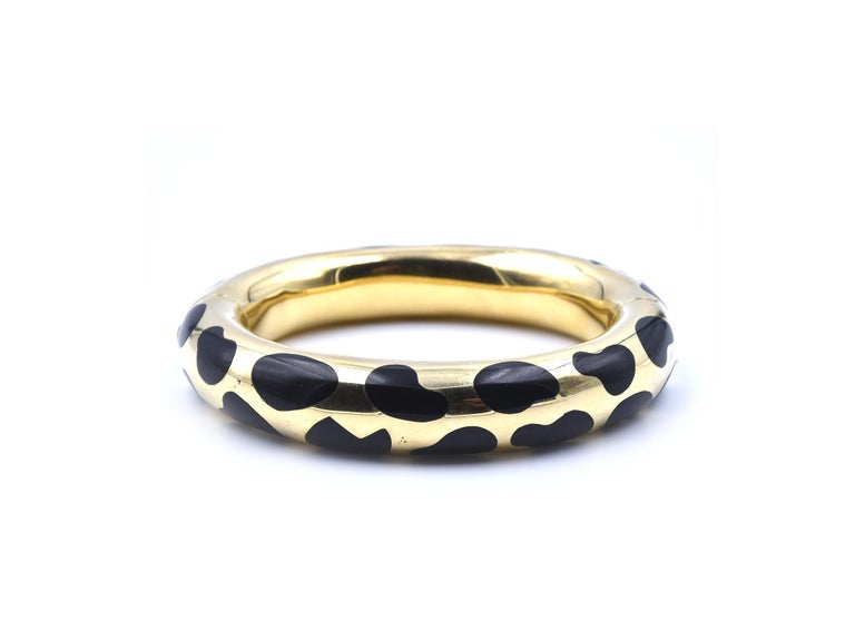 Designer: Tiffany and Co. by Angela Cummings Material: 18k yellow gold and black jade Dimensions: bangle will fit a 6 ½-inch wrist and it is 13.66mm wide Weight: 74.28 grams Retail: $15,500 in 1980's