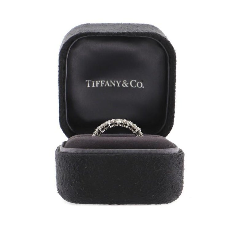 Estimated Retail Price: $15,500 Condition: Great. Minor wear throughout. Accessories: No Accessories Measurements: Size: 6.5 Designer: Tiffany & Co. Model: Aria Eternity Band Ring Platinum and Diamonds 6.5 Exterior Color: Silver Item Number: 80404/11