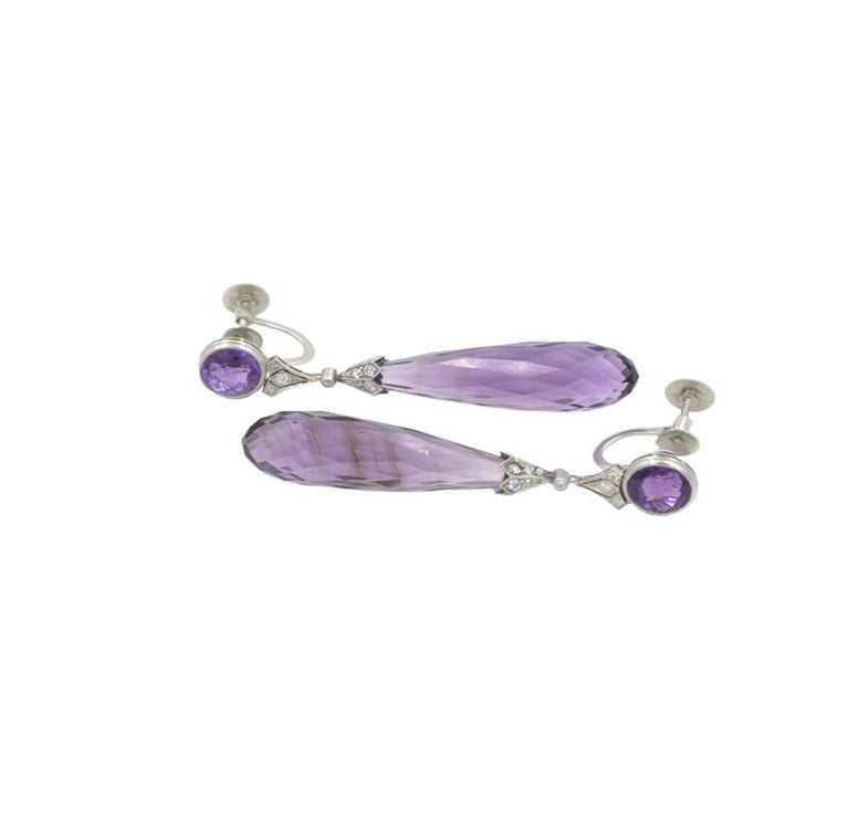 Tiffany & Co Platinum Art Deco earrings with Amethyst briolettes and 26 diamonds, 0.40cts.  7mm round amethysts and 28mm briolette amethysts. Screw back clips.  Marked
