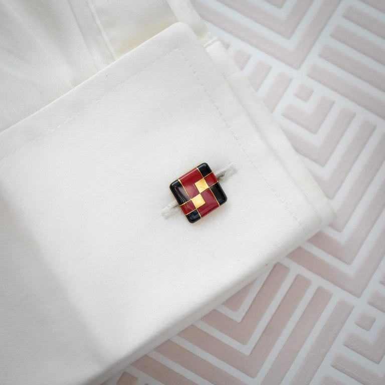 A pair of red and black enamel on gold cufflinks, with geometric designs. One bar is signed Tiffany & Co. With French eagle marks for 18ct gold and maker's marks, circa 1925.