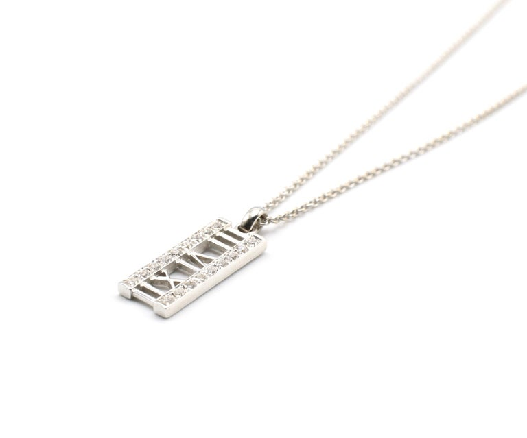 Tiffany And Co. Atlas 18k White Gold Diamond approx 0.31 ctw Bar Pendant 16 inch   Metal: 18k White Gold Weight:  6.69 grams 18 Round Brilliant Cut Diamonds weighing approximately 0.31ctw G VS Chain Length: 16 inches Pendant measures approx .75