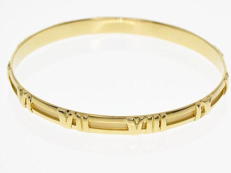 c4dc0d42f Name:Atlas Gold bangle Material :750 K18 YG Yellow Gold. Tiffany & Co.