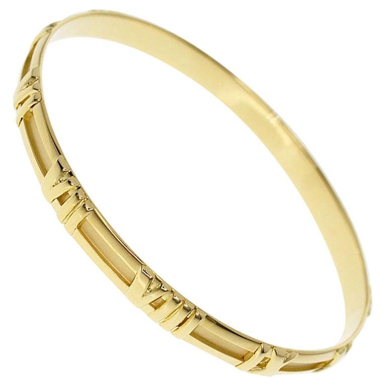 efa378de1 Tiffany and Co. Atlas 18 Karat Yellow Gold Bangle 20cm For Sale at ...