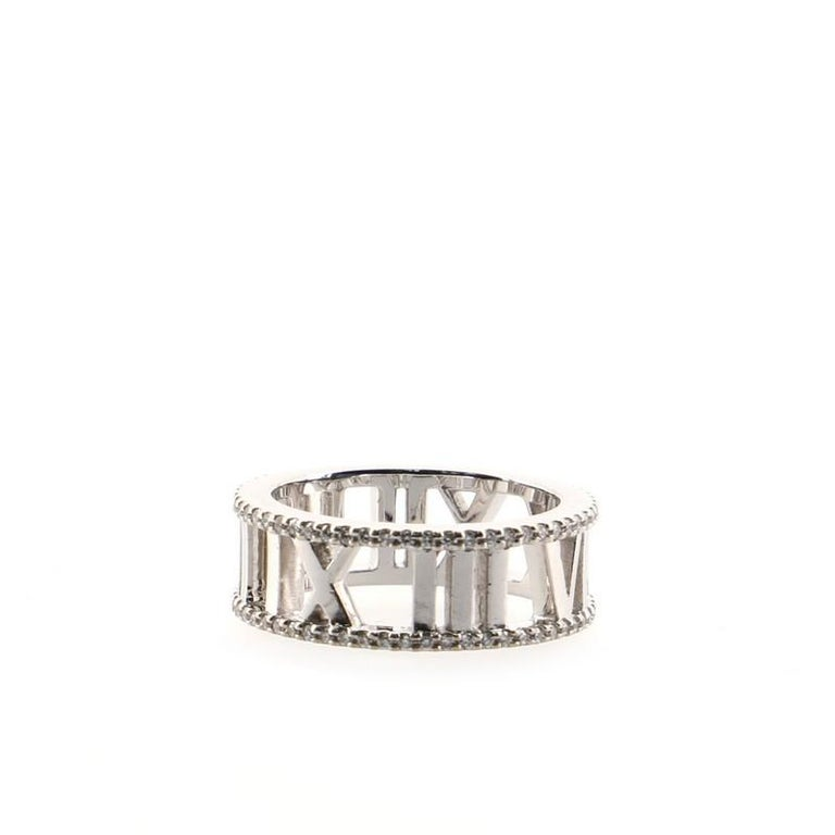 Condition: Very good. Shows moderate scratches throughout gold. Accessories: No Accessories Measurements: Size: 5, Width: 6.95 mm Designer: Tiffany & Co. Model: Atlas Open Ring 18K White Gold and Diamonds 7mm Exterior Material: 18K White Gold,