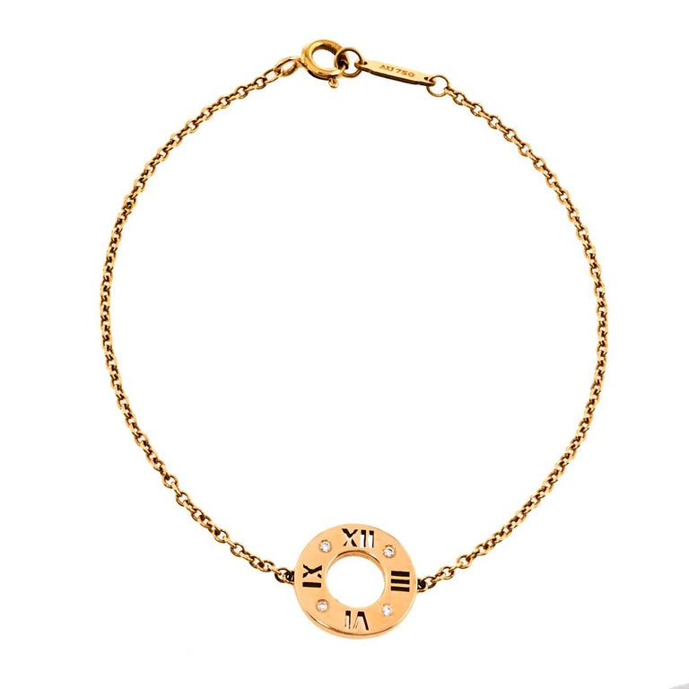With its bold numeric motif and strong lines, the Atlas collection honors Tiffany's most celebrated symbols. Four small sparkling diamonds add a touch of elegance and opulence to this minimalistic bracelet made from 18K rose gold and secured by a