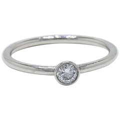 Tiffany & Co. Bezet Round Brilliant Diamond and Platinum Ring