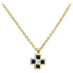 Tiffany & Co. Blue Sapphire Diamond Mini Cross 18 Karat Gold Pendant Necklace