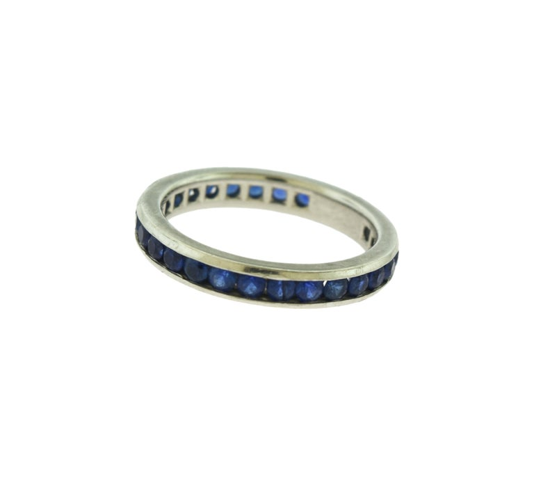 Brilliance Jewels, Miami Questions? Call Us Anytime! 786,482,8100  Ring Size: 5.5   Designer: Tiffany & Co.  Style: Eternity Band  Metal: Platinum   Metal Purity: 950   Stone: Blue Sapphire  Band Width: 3 mm   Total Carat Weight : Approx. 1.35