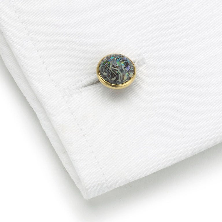 A pair of antique Tiffany & Co. cabochon boulder opal cufflinks, each set with a circular domed boulder opal matrix, mounted in gold, with figure-of-eight links, signed