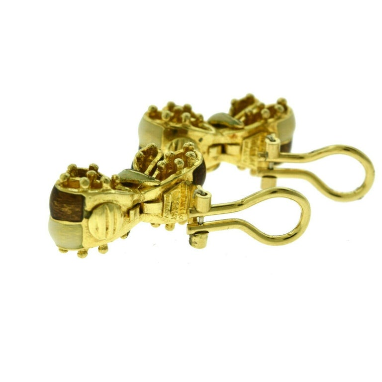 Designer: Tiffany & Co.  Style: Bow Tie Clip On Earrings  Metal: Yellow Gold  Metal Purity: 18k  Non-Metal Material: Brown and White Enamel  Total Item Weight (grams): 21.8  Earring Dimensions: approx. 1.0 x 0.5 inches  Signature: TIFFANY & CO. 18k