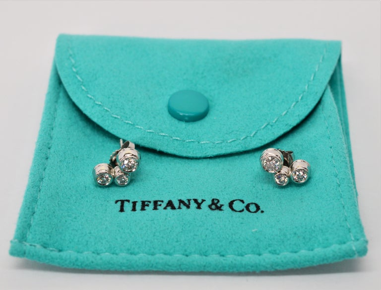 New, with Tiffany & Co. signature pouch. Tiffany & co. Bubble Diamond Platinum Earrings. Each earring stud has three round brilliant diamonds,  .43 carats total weight, bezel set in .950 platinum. The approximate measurement of each is 11 mm in