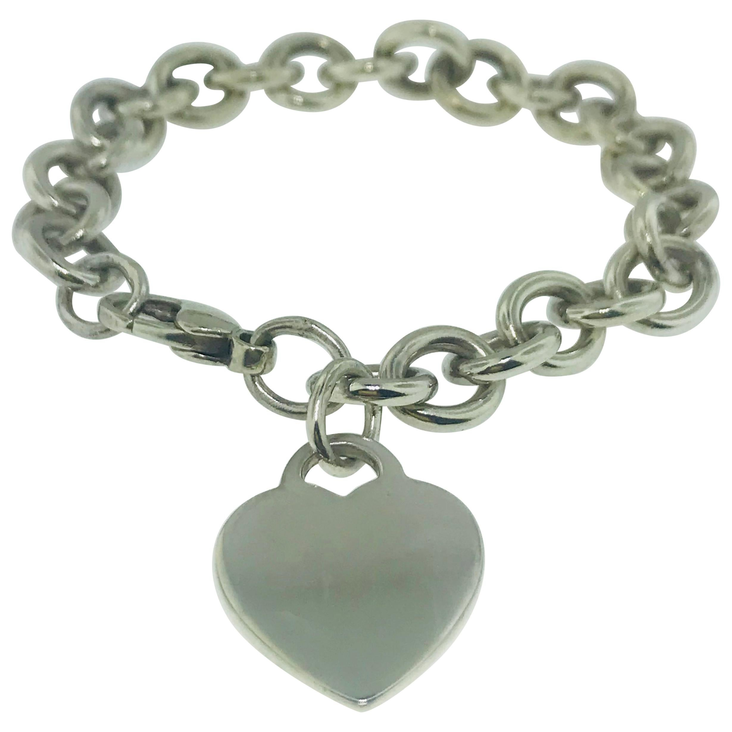 cda1c7a2fe2ae Tiffany & Co. 18 Karat Yellow Gold Heart Tag Charm Bracelet