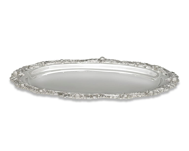 This sterling silver tray was crafted by the incomparable Tiffany & Co. in the widely recognized Chrysanthemum pattern. The motif's namesake flowers are expertly chased and applied around the elegantly scalloped rim. Expertly crafted, the highly